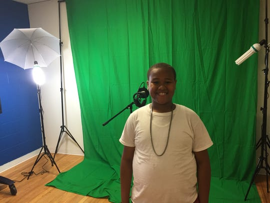 Tylik Pugh in front of the new studio in the innovation lab at the Asbury Park Boys and Girls Club