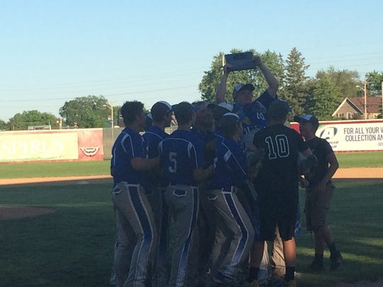 Athens' players carry lone senior Jake Stange following the Bluejays thrilling, 9-3 sectional title win.