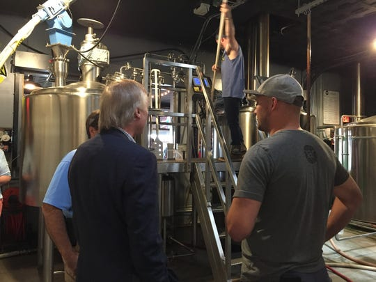 J.T. Merryweather, right, of RaR Brewing chats with Comptroller Peter Franchot, center, and Dorchester County Council President Ricky Travers at RaR Brewing in Cambridge, Maryland on Tuesday, June 27.