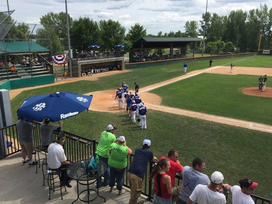 Pierz players line up to congratulate Noah Boser after his two-run home run in the third inning Sunday.