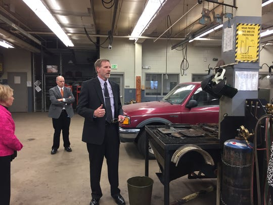 Director Mark Day leads a tour of the auto shop at the Boys State Training School at Eldora in 2016.