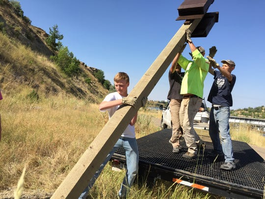 """Adam Blake,15, installed six bat houses along the River""""s Edge Trail as his Eagle Scout project."""