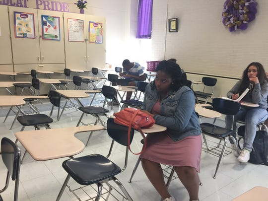 Students take notes on the first day of Carmon James' geometry class at Wossman High School on Monday.