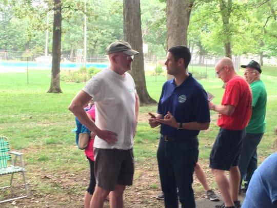 Iowa Sen. Nate Boulton, right, talks with Iowa City