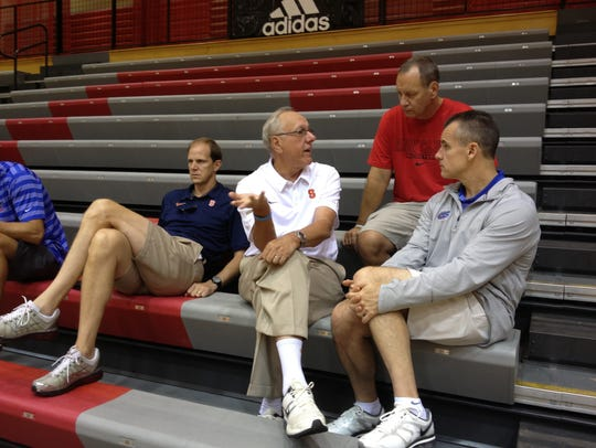 FILE – College basketball coaches, from left Syracuse