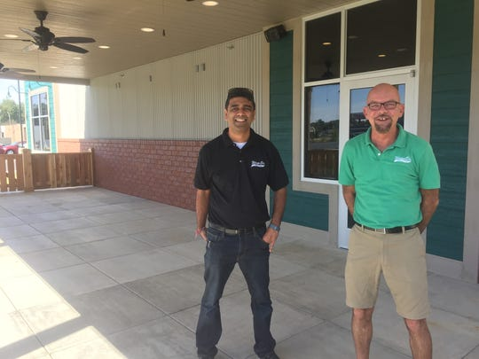 Owner Manish Malhotra, left, and General Manager Shane O'Leary, right, talk about plans for live entertainment on the Wings Etc. covered patio.