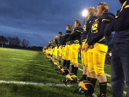 Members of the Climax-Scotts football team stand for the national anthem ahead of their matchup with Fulton on Friday.