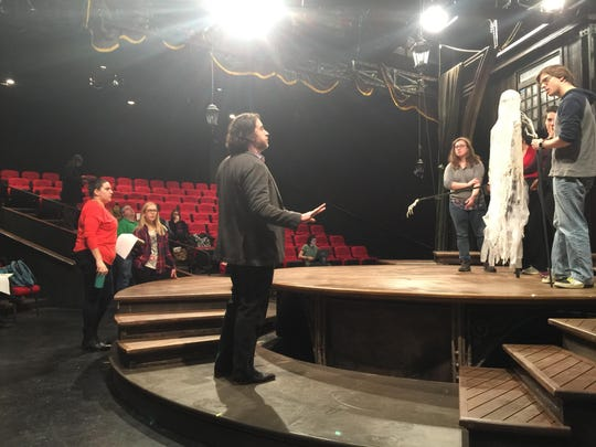 """Director Michael Barakiva speaks with actors and tech staff about the transition to Scrooge's future during rehearsals for the Hangar Theatre's production of """"A Christmas Carol."""""""