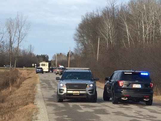 Investigators and police vehicles can be seen Thursday afternoon on Schacht Road in the town of Peshtigo where a fatal officer-involved shooting occurred earlier.