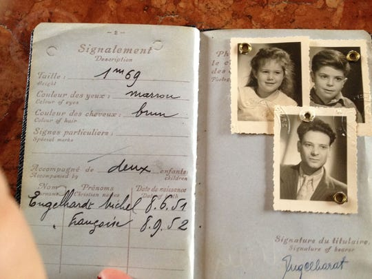"A French passport is among the items featured in the ""Your Story, Our Story"" project."