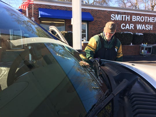 Gary Jaco dries a vehicle by hand Thursday at Smith