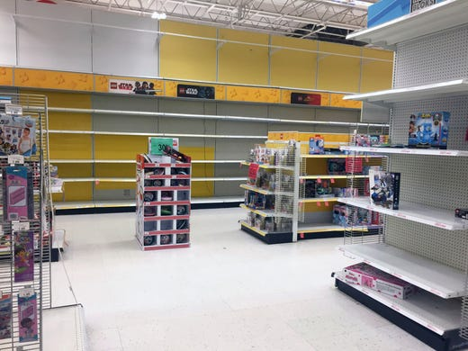 Empty shelves and sales items are all that remain in 502f71ab52