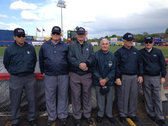 Joe Yanuzzi stands among his fellow umpires at a Wounded Warriors Game at NYSEG Stadium.