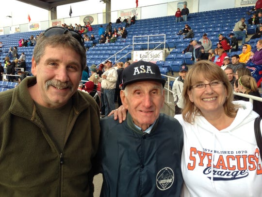 Joe Yanuzzi (center) attends the Wounded Warriors game with his son, Joe Yanuzzi, and daughter, Karen Reardon.