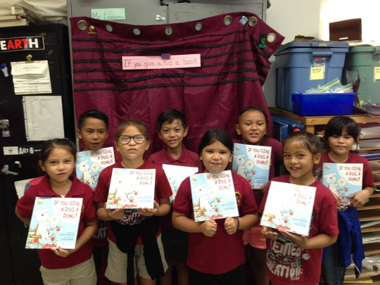 "The second-grade G.A.T.E. students of Capt. H.B. Price School participated in activities to celebrate the reading and summarizing of over 36 books throughout the school year on May 18, 2018. Each student was presented their own copy of Laura Numeroff's book ""If You Give a Dog a Donut."" Front row from left: Isabel Reyes, Sierra Grino, Vayla Gumabon, and cyan Sablan. Back row from left: Drady Cruz, Skyler Francisco, Sophia Nangauta, and Victoria Roberto."