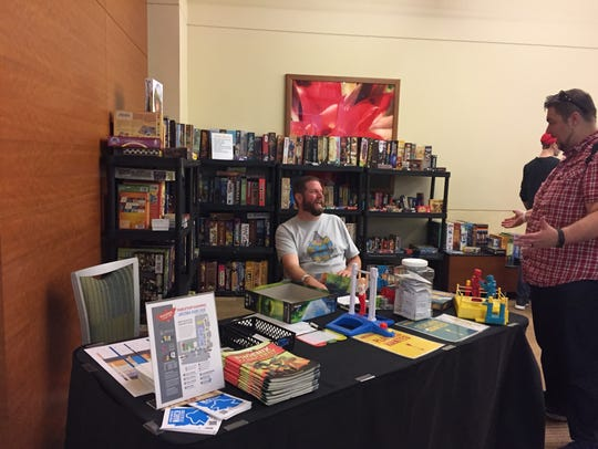 A vendor displays tabletop games can be taken, played