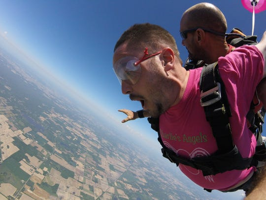Nick Buckley during the free fall portion of his tandem skydive with Dennis Bennett of Skydive Allegan.