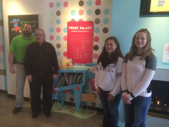 Ashwaubneon High School sophomores Monet Parrett, second from right, and Katelyn Huebner, right, took the initiative to make their art project in Dean Stadel's, second from left, class a reality with help from technology and engineering teacher Dale Stroud, left.