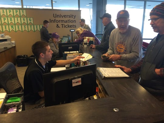 Fans of the University of Wisconsin-Stevens Point men's basketball team get tickets for Friday night's NCAA Division III tournament game on Tuesday at the UWSP ticket office.