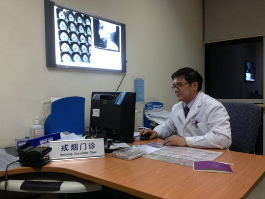 At Beijing's Chaoyang hospital, doctor Guo Xiheng runs