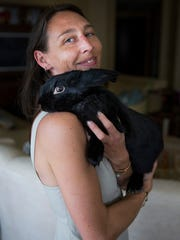 Larisa Byerhof holds her rabbit, Sweetums, on Thursday, November 9, 2017 at her home in the Aqua condominiums in North Naples.