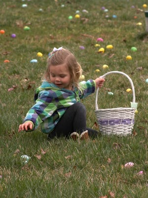 A young girl participates in a previous Easter egg hunt at Timberland Park in Franklin.