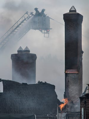 Firefighters battle a Friday blaze at the 92-year-old Western Golf and Country Club in Redford Township.