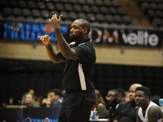 Bennett head coach Andre Collins signals to his team during their game against Snow Hill on Wednesday, Dec. 21, 2016 at the Governor's Challenge Tip-Off at the Wicomico Youth and Civic Center.