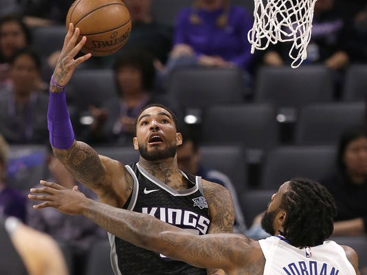 Sacramento Kings center Willie Cauley-Stein, left, goes to the basket against Los Angeles Clippers center DeAndre Jordan during the first quarter of an NBA basketball game Thursday, Jan. 11, 2018, in Sacramento, Calif. (AP Photo/Rich Pedroncelli)