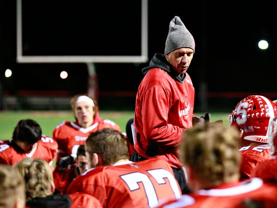 Susquehannock coach Steve Wiles talks to his team after its 45-14 loss to East Pennsboro in the opening round of the District 3 4-A playoffs. The Warriors were the only Y-A League team to host a playoff game and just one of two higher seeds from the Y-A League in the District 3 postseason. Dawn J. Sagert photo