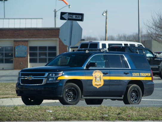 A State Police Department vehicles leaves the agency's