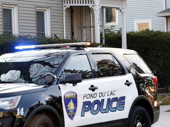 A Fond du Lac Police vehicle sits outside 120 East Second Street Wednesday after it was called to the house for a 3-month-old child that was unresponsive and not breathing.