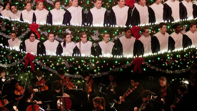 Mona Shores choir students perform during the annual Singing Christmas Tree at the Frauenthal Center in Muskegon, Mich., on Thursday, Dec. 3, 2015. The Mona Shores Singing Christmas Tree combines the usual elements into an unusual show that will draw thousands of spectators.