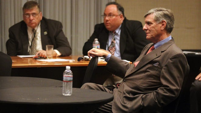 Ocean County Republican Chairman George Gilmore (right) meets with his organization's leadership in 2014 to discuss who the party would endorse that year for the GOP nomination for U.S. Senate. In the background (from left to right) are Ocean County Sheriff Michael G. Mastronardy and Berkeley Mayor Carmen F. Amato Jr.