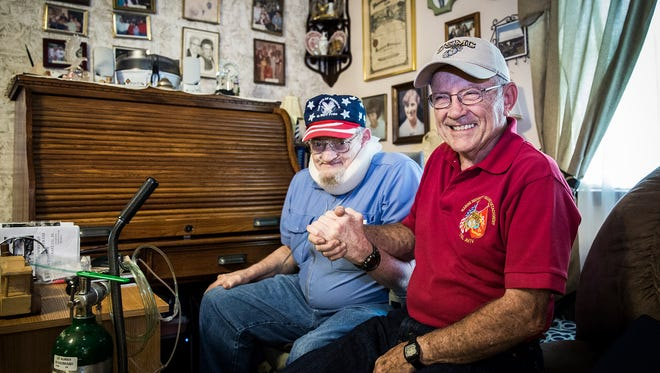 Fred Wyman and Frank Wehrly greet each other at Wyman's home in Muncie Wednesday afternoon.  Wyman and Wehrly have been selected to take the Honor Flight to Washington D.C.