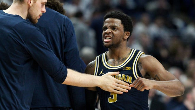 Michigan Wolverines guard Zavier Simpson (3) reacts during a timeout during the second half against the Penn State Nittany Lions at Bryce Jordan Center. Michigan defeated Penn State 72-63 on Wednesday, Feb. 21, 2018.