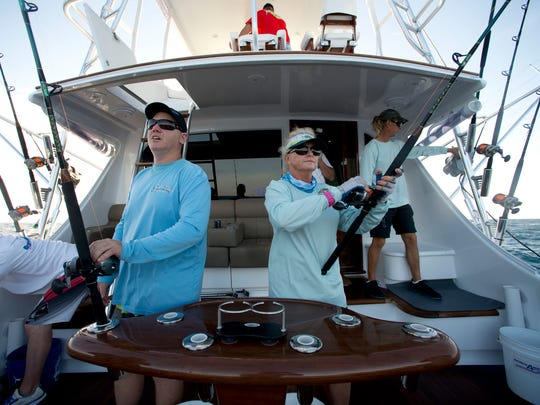 Anglers aboard the Showtime! stand at the ready during a sailfish tournament in 2015. The Light Tackle Sailfish Tournament takes place Friday through Sunday.