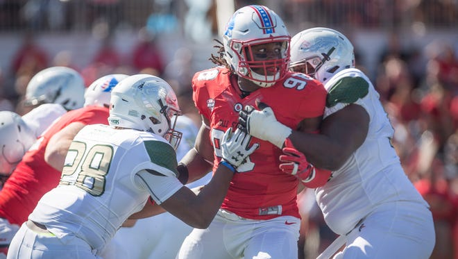 Ball State's Anthony Winbush is blocked as he tries to get to UAB's quarterback Sept. 9 at Scheumann Stadium.