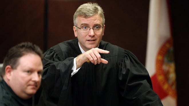 In this Dec. 10, 2009, file photo, Judge Mark Walker makes an inquiry during a murder trial.