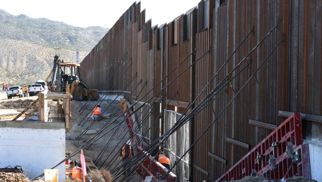Work continues on an 18-foot high section of the border fence near Sunland Park, N.M.