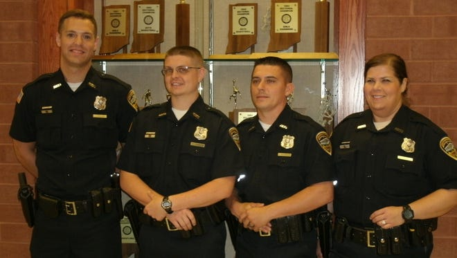 Four Richmond Police Department officers graduated Friday from the Indiana Law Enforcement Academy in Plainfield. Those graduating were (from left) Officer Jordan Brouse, Officer Brett Haskett, Officer Jeremiah Holbrook and Officer Jenny Meadows.