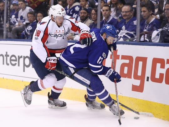 Toronto Maple Leafs right wing Connor Brown, right,