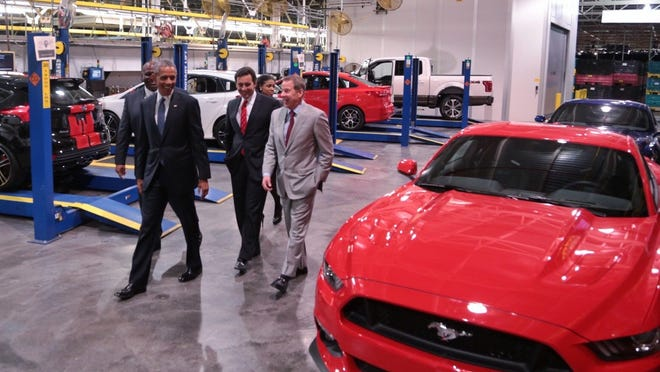 President Barack Obama checks out a 2015 Ford Mustang with Executive Chairman Bill Ford and CEO Mark Fields at the automaker's Michigan Assembly Plant in Wayne on Jan. 7.
