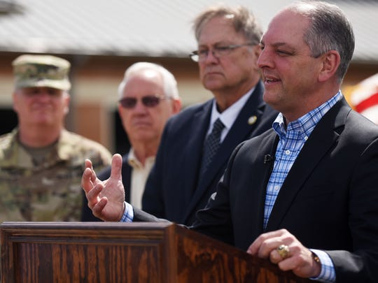 Louisiana Governor John Bel Edwards talks to the press