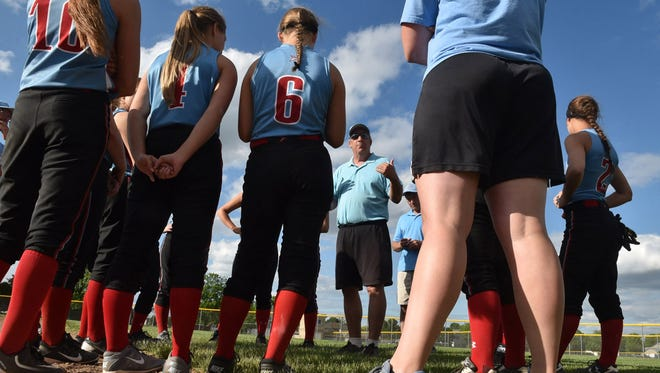 Southern Door softball coach Pat Delcore talks to the team after losing the sectional championship to New London, 9-3, on Thursday, June 2, 2016.
