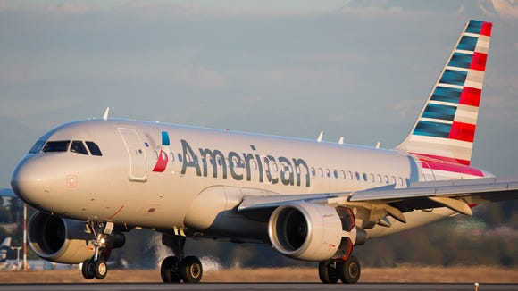 An American Airlines Airbus A319 lands at Seattle-Tacoma
