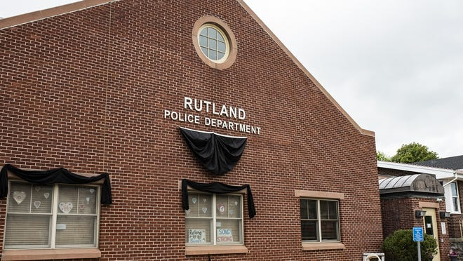 Black bunting covers the Rutland Police Department after the death of Detective John D. Songy from COVID-19.