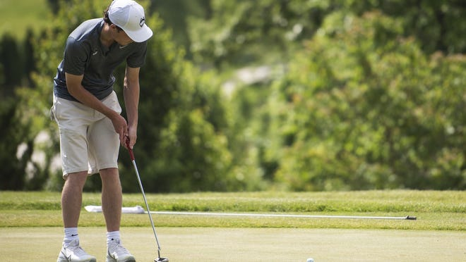 Tim Umphrey hits a putt during the Cosgrove Golf Tournament at Green Hill Golf Course on Saturday.