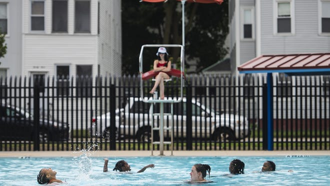 Children splash in the water on opening day at Crompton Park pool in Worcester on Wednesday.