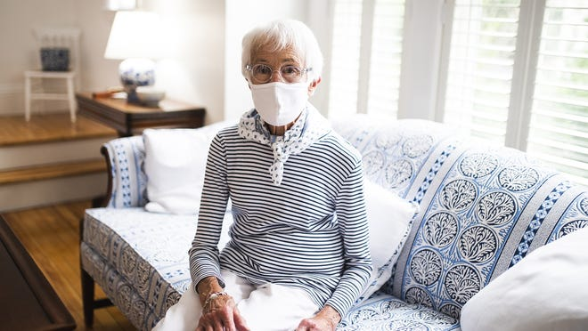 Patricia Rushton in her Worcester home on Wednesday. Rushton, and others with hearing impairments, say  they are finding it more difficult to understand when people speak while wearing masks.